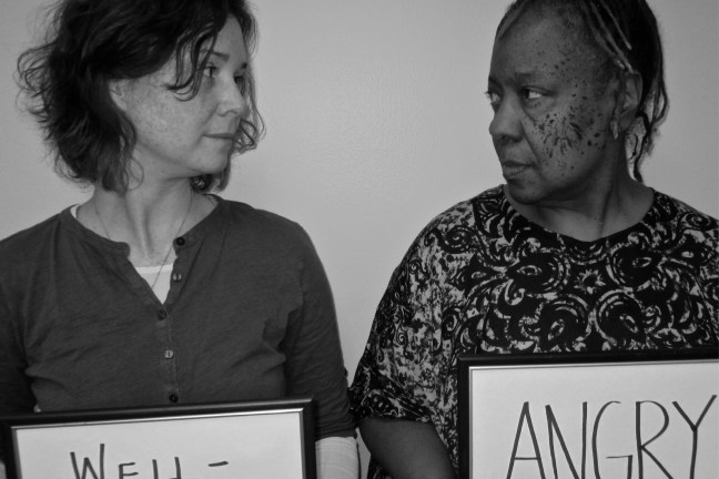 "Two women look directly at one another. At left is a white woman holding a sign that says ""Well-Intentioned."" On the right is a Black woman holding a sign that, in all capital letters, reads ""Angry."""