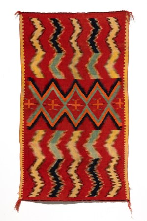 Artist unknown, this Navajo rug from the1890s contains bright reds, yellows, and oranges in geometric vertical patterns.