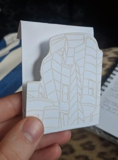 An early rendition of Claymate packaging featuring an engraved Weisman Art Museum profile.