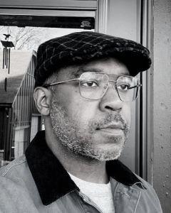 Black and white headshot of Lamar Peterson
