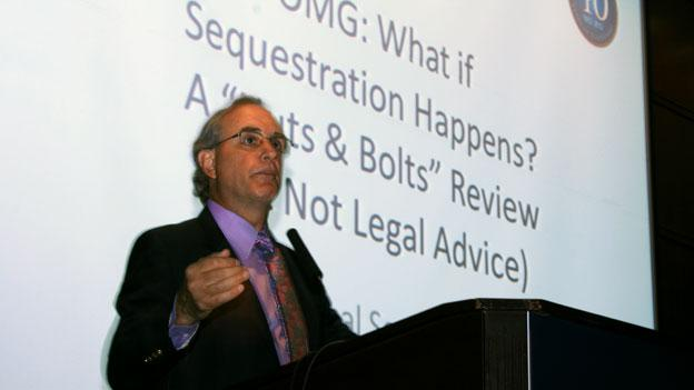 """Stan Soloway, president and CEO of the Professional Services Council, addresses federal contractors at a meeting called """"OMG: What if sequestration happens?"""" in Arlington, Va. earlier this month."""