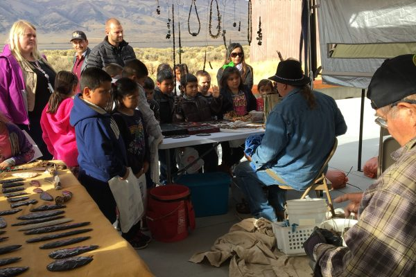 Onlookers watching a flint knapping presentation at Wanapum Heritage Center Archaeology Days