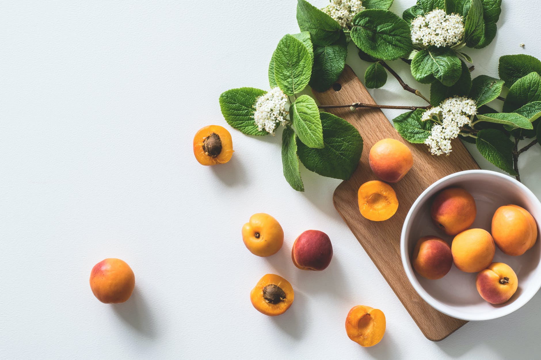apricot fruits on bowl