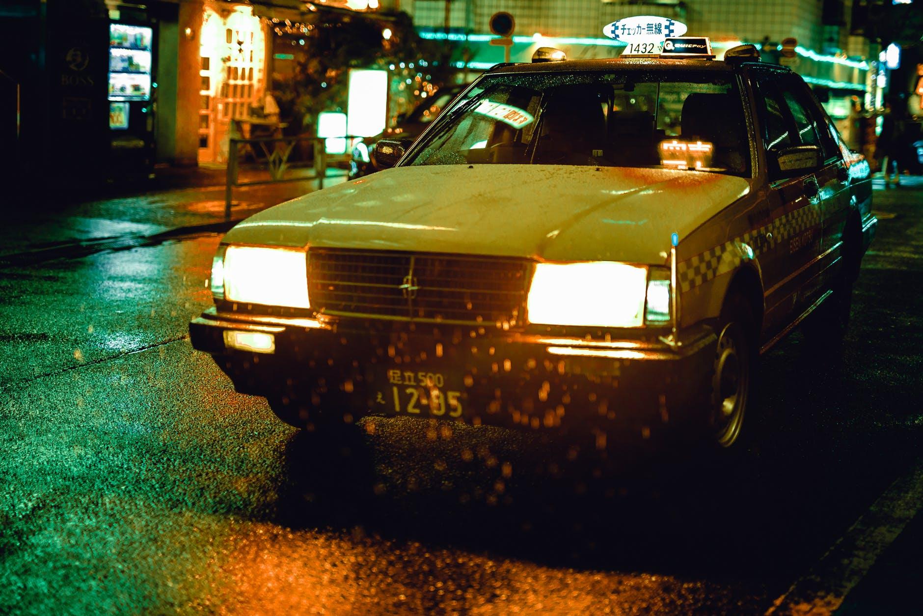 white sedan during nighttime