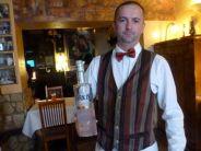Polish waiter waiter Mariusz Scetlak with spelt vodka at Pod Baranem.