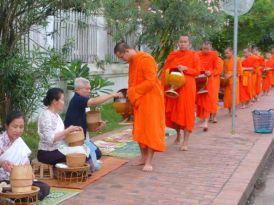 Buddhists with begging bowels Luang Prabang, Laos.
