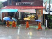 Morning kiddie monk parade with begging bowls in Pak Beng, Laos.
