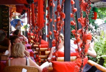 Spot the photographer in the mirror among the roses. A restaurant.