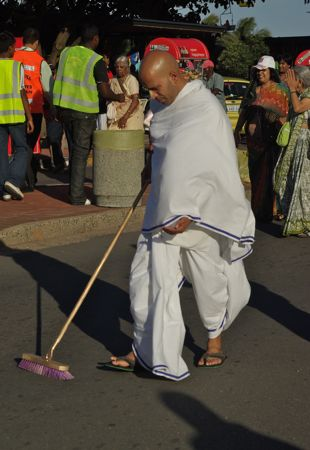 Sweeping the street in front of the parade.