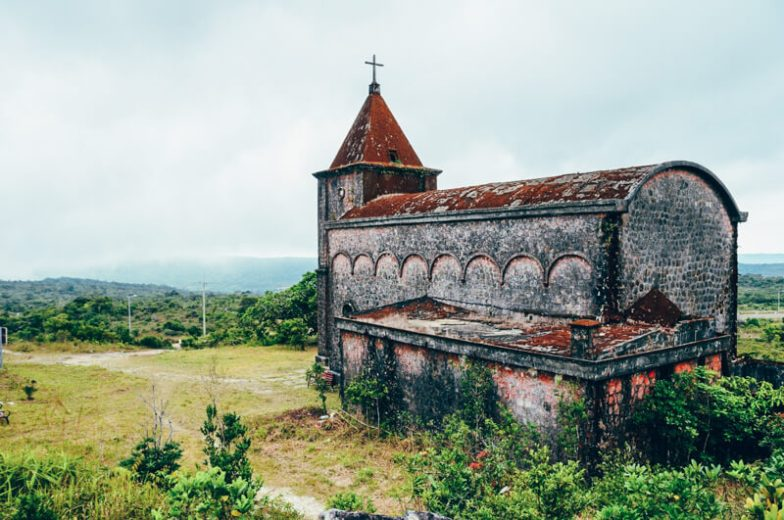 An old brick church lies abandoned in Bokor National Park near Kampot, Cambodia.