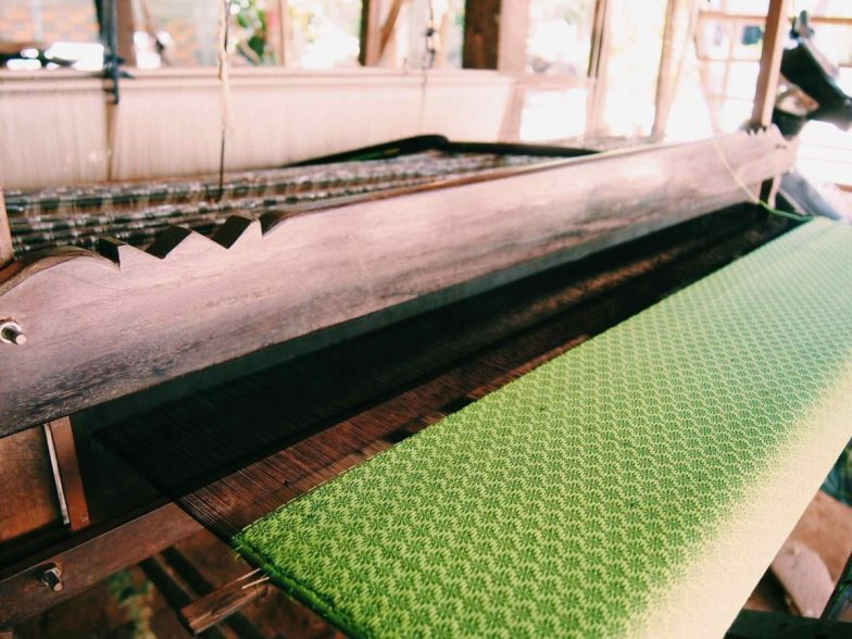 A green cloth on a loom on Koh Dach.