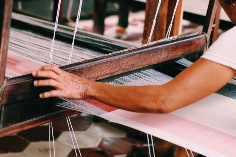 A woman weaving.