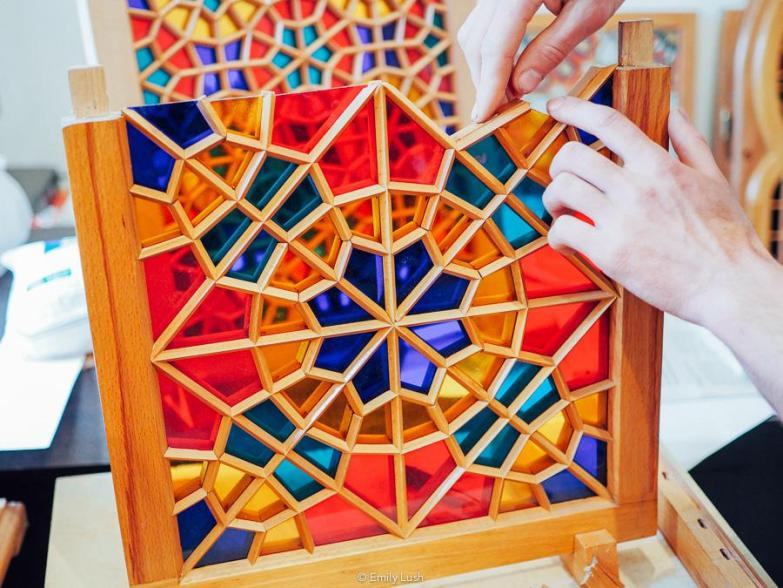 A man making stained glass.