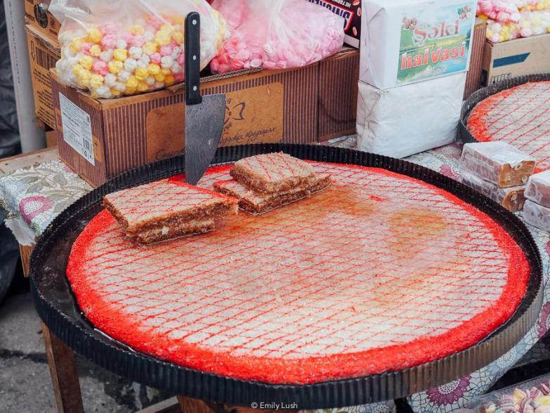 A large round pan of halva in Sheki.