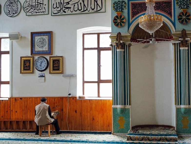 A man prays inside a colourful mosque in Georgia.