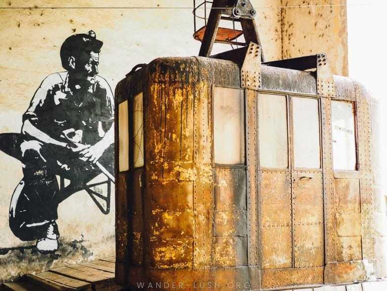 A rust-coloured cablecar.