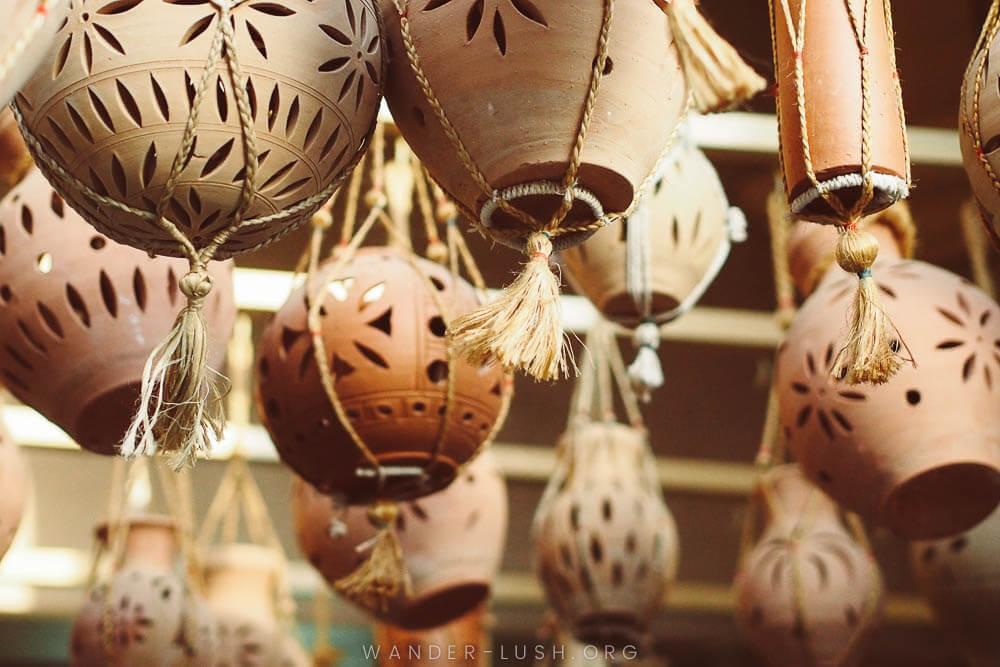 Hanging pots at Nizwa Souq. Photo credit: Emily Lush.