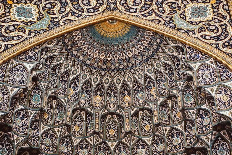 A mosaic roof inside the Sultan Qaboos Grand Mosque in Muscat. Photo credit: Copyright Emily Lush | Oman road trip