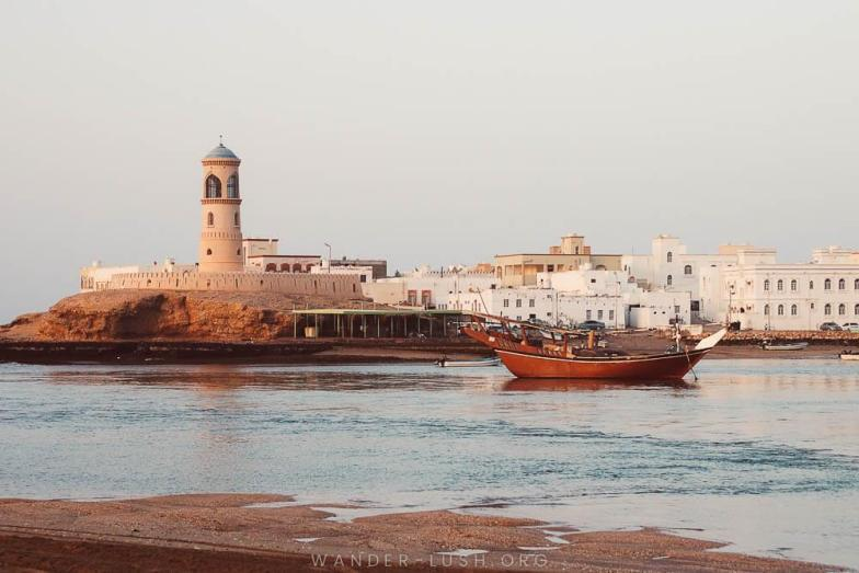 A dhow boat off the coast of Sur, Oman. Photo credit: Copyright Emily Lush | Oman road trip