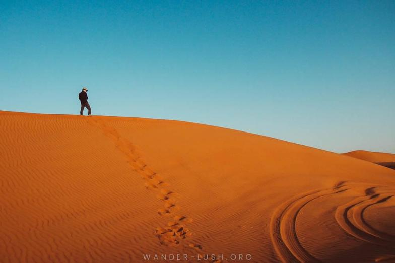 Climbing on the dunes in Oman's Wahiba Sands. Photo credit: Emily Lush.