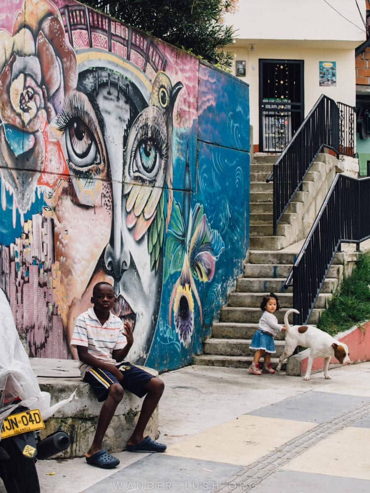 Thinking of visiting the Comuna 13 street art area? Here are 13 things you need to know before you sign up for a Comuna 13 tour in Medellin, Colombia.