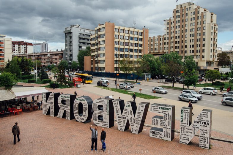 Selfie time at Prishtina's iconic Newborn monument | Things to do in Prishtina city, Kosovo—including the best cultural attractions, designer cafes and architecture. Use this guide to plan your Kosovo travel!