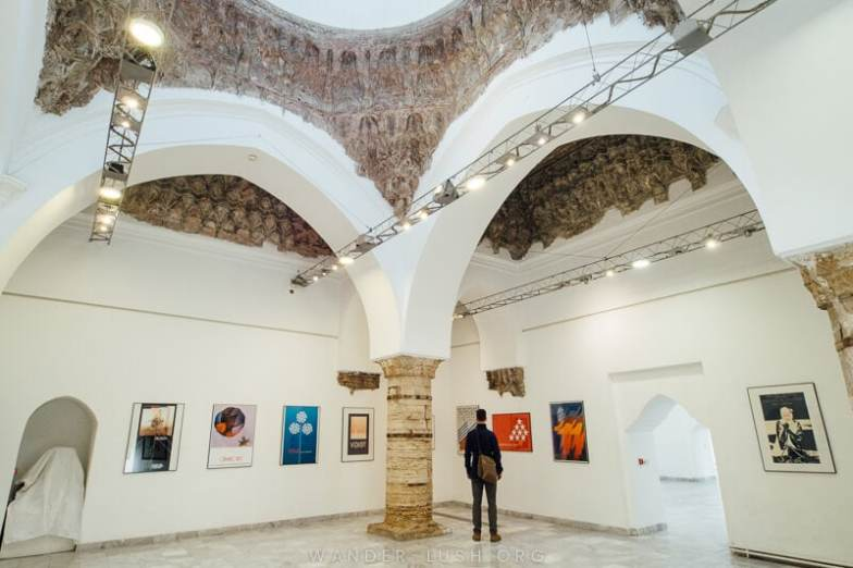 An art exhibition inside Daut Pasha Hamam.