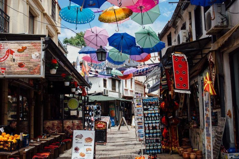 Colourful umbrellas hanging over a street in Skopje Old Bazaar.