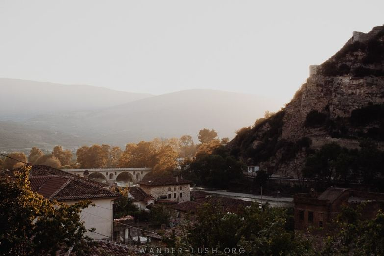 Sunset view of the city and stone bridge, one of the best things to do in Berat.
