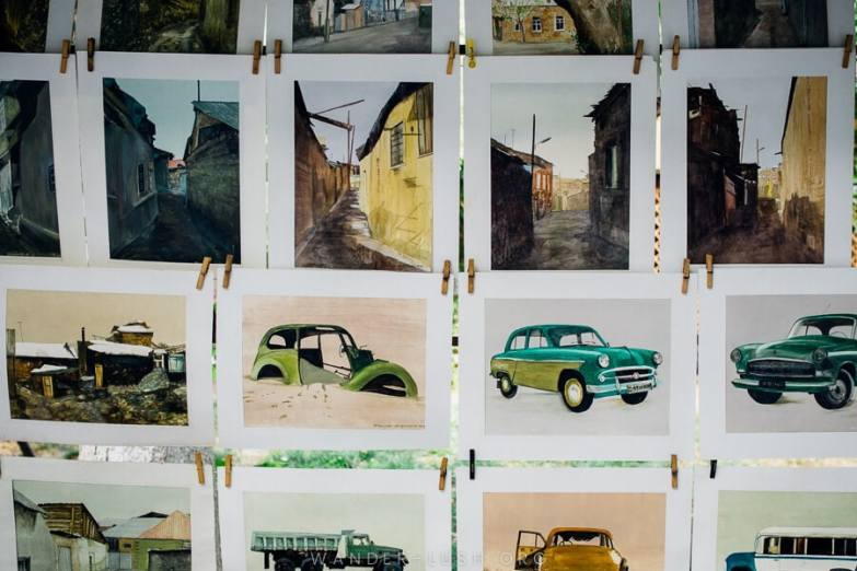 Art prints featuring old Soviet cars at the Vernissage Market in Yerevan.