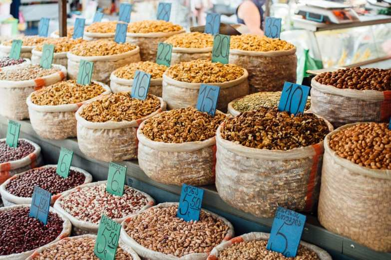 Bags of nuts stacked at a market stall.