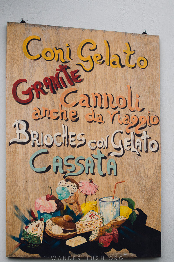A wooden sign advertising a dessert shop in the Aeolian Islands.