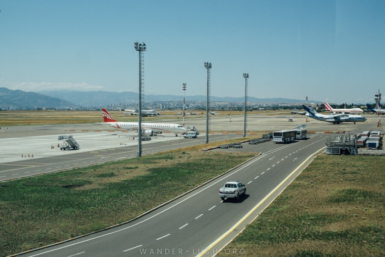 Airplanes waiting on the runway at Tbilisi Airport.