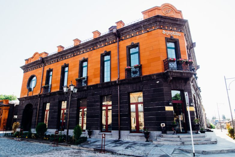An orange and black stone building.