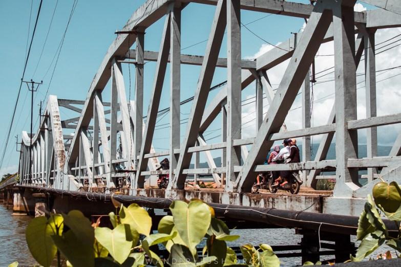 A steel bridge over a river.