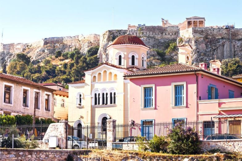 Colourful pink and yellow houses in Athens.