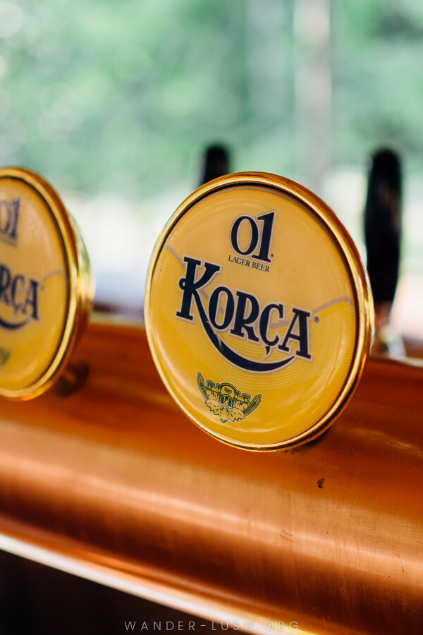 A beer tap reading 'Korca'.