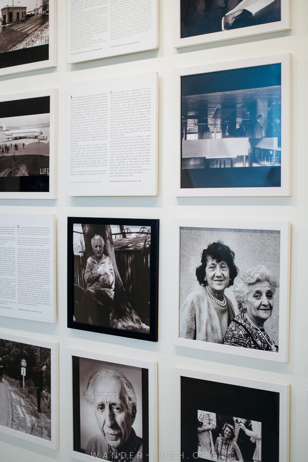 A wall of photographs and framed letters at a museum in Korca.