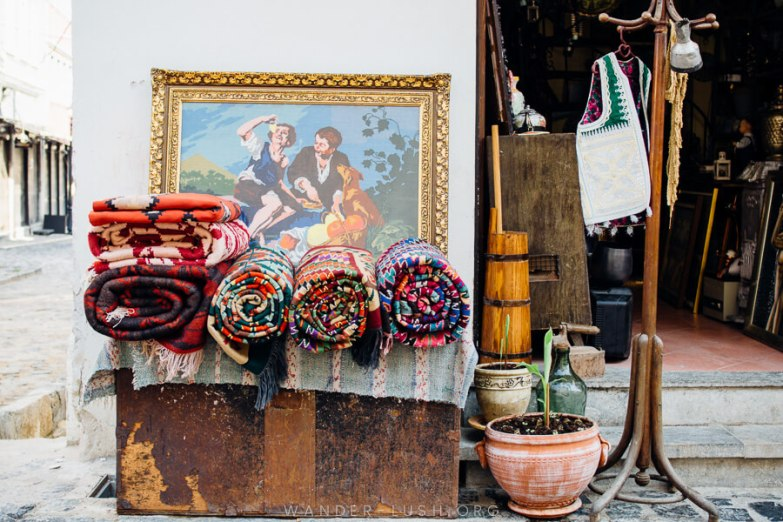 An antique shop in Korca, with rolled carpets out the front.