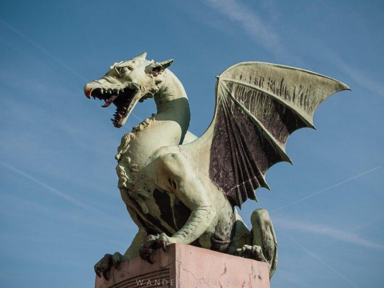 A green dragon statue.