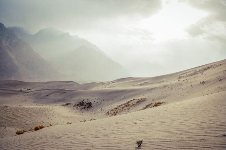Sand dunes and mountains in Pakistan.