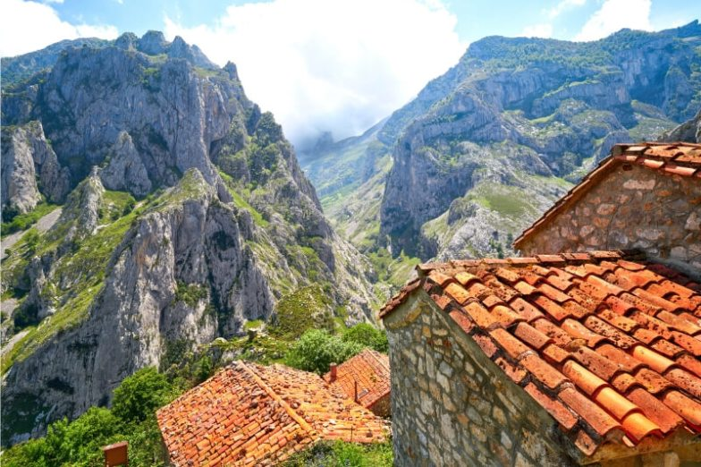 The tops of houses in the mountains in Spain.