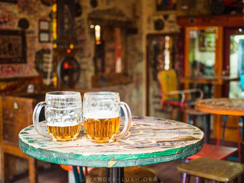 Two glasses of beer on a table in a bar in Budapest.