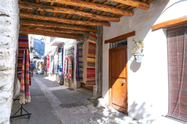 White walls and wooden doors in a village in Spain.