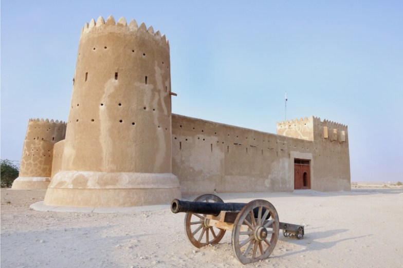 A sand-coloured fort with a canon out the front.