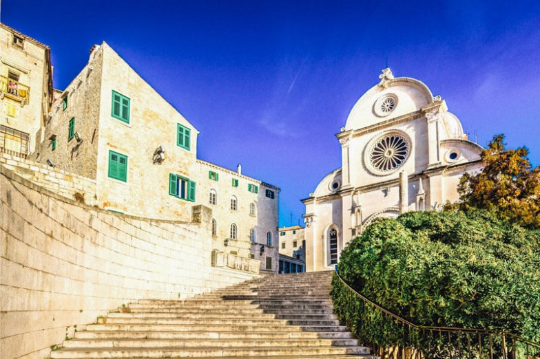 Stone stairs and a church facade in Sibenik, Croatia.