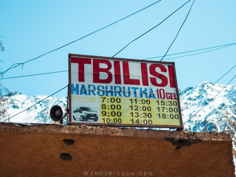 A sign at the bus station in Kazbegi with the Kazbegi to Tbilisi bus times.