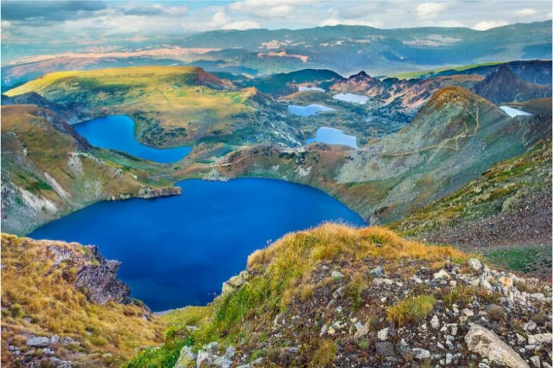 A series of bright blue lakes in the mountain in Bulgaria.