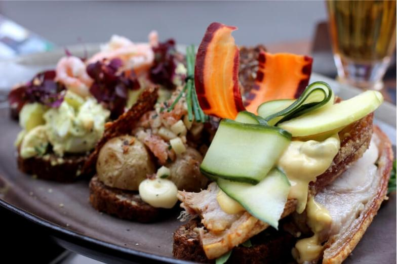 Smorrebrod, traditional open-faced Danish sandwiches topped with a colourful array of ingredients.