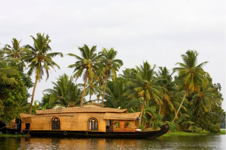A large wooden houseboat in Alleppey.
